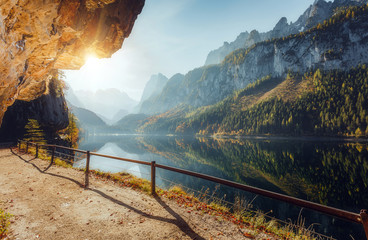 Fotomurales - Wonderful Sunny Landscape at Vorderer Gosausee lake in Austrian Alps. Awesome alpine highlands at sunset. Fairy autumn scene in Alpine highland.  Picturesque view of nature. amazing natural Background