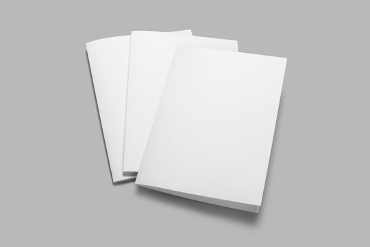 Three white folded pieces of paper on gray background