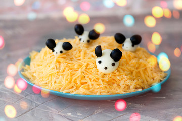 Cute salad - white mouse on the cheese from eggs and olives, bokeh