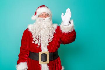 Santa Claus waving to kids