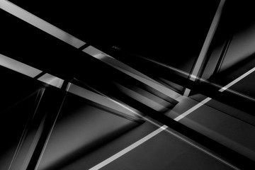 Fragment of modern architecture / interior with glowing lines in darkness. Abstract black geometric background with luminous angular / triangular structure in grunge style. Wall mural