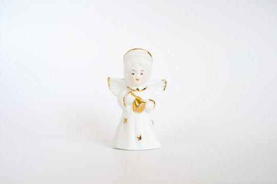 Ceramic angel figurine on a white background