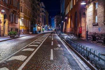 Bolzano, Italy 24 November 2019: City streets of South Tyrol under the cover of night