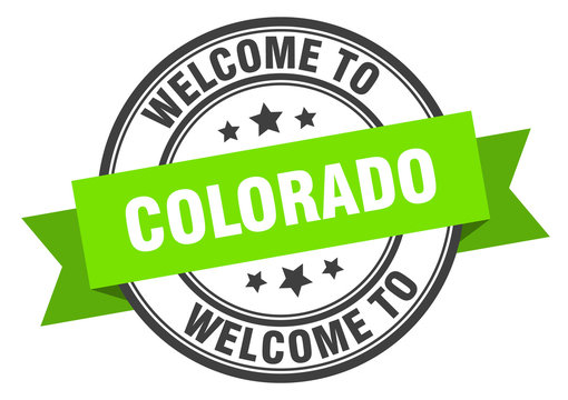 Colorado stamp. welcome to Colorado green sign
