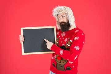 Schedule timing concept. Bearded man blank blackboard copy space. Guy santa claus red background. Chalkboard for information. Presentation concept. Winter announcement. Winter event. Winter holiday