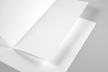 Blank Folded Sheet of Paper, Letterhead, or Flyer over Stack of Paper