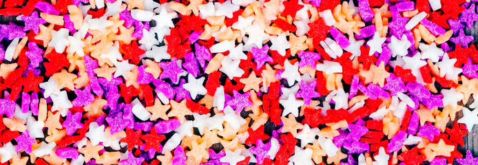Cake decorations - sweet candy toppings in sugar stars, as a long food banner / panorama / header.