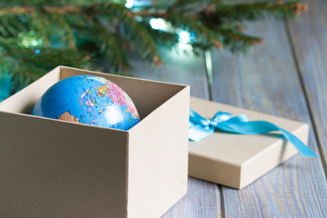 Globe in gift box. Travel gift for Christmas concept