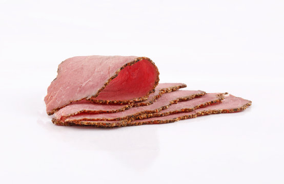 slices perfectly arranged of roast beef on white background