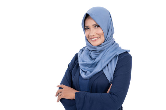 Pose of old hijab woman with crossed hands and smile look at camera at isolated background