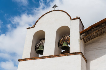 White Spanish mission church bell tower with two bells in Santa Barbara, California, USA