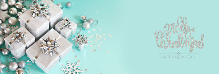 Christmas banner. Xmas silver and glitter gifts box, blue background. Horizontal poster, greeting...
