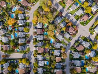 Top View of Residential Neighbourhood in Montreal Showing Trees Changing Color During Fall Season in Quebec, Canada