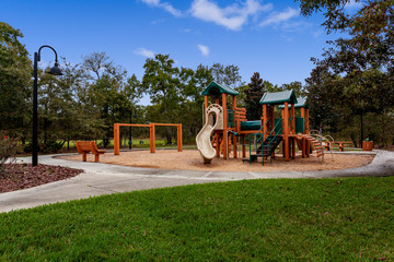 Wooden playground with a slide and swingset