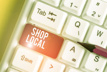 Word writing text Shop Local. Business photo showcasing a preference to buy locally produced goods and services White pc keyboard with empty note paper above white background key copy space