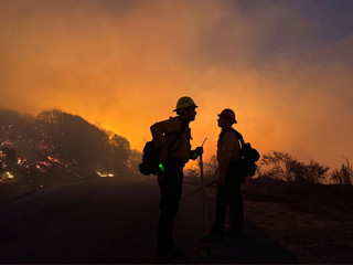 Firefighters battle the Cave fire in Los Padres National Forest near East Camino Cielo
