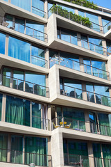 Detail of an apartment building with floor-to-ceiling windows seen in Berlin, Germany