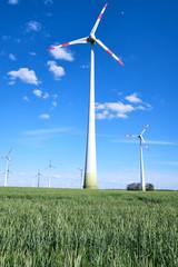 Wind energy generators in a cornfield seen in Germany