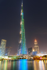 Amazing night view of the Burj Khalifa Tower by lake