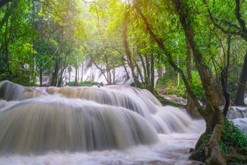 Papiers peints Kaki Waterfall scene at Pha Tad Waterfalls in rainforest at the Khuean Srinagarindra National Park Kanchanaburi.