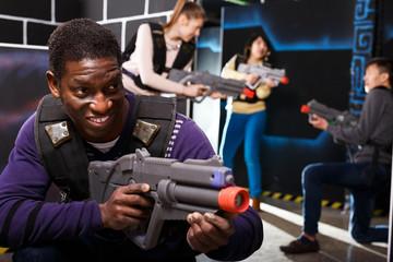 African American man playing lasertag