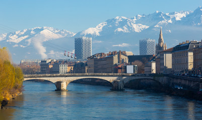 Fotobehang Stad aan het water Cable cars over river and bridge in Grenoble in autumn
