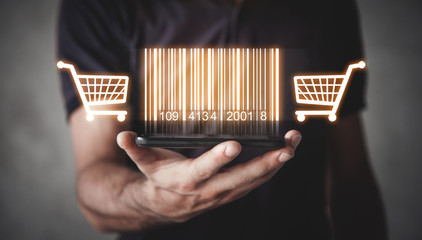 Businessman showing bar code with shopping cart. Warehouse, logistic, shopping