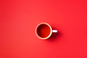 Printed roller blinds Tea Cup of tea on red background. Top view. Copy space. Banner. Autumn or winter season concept