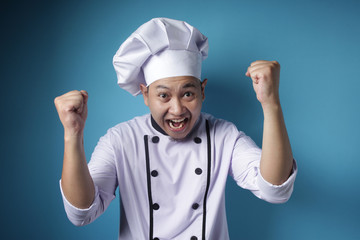 Happy Proud Asian Chef Shows Winning Gesture