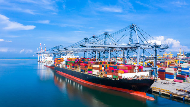 Container cargo ship at industrial port in import export business logistic and transportation of international by container cargo ship in the open sea.