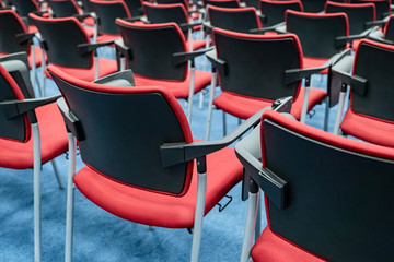 Chairs. Red chairs in the conference room. Chairs in the auditorium. Concept - organization of conferences. Concept - sale of office furniture. Auditorium. Conference hall. Furniture manufacturing