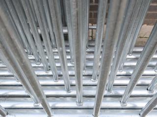 row of metal fences on the sidewalk in Amsterdam, detail