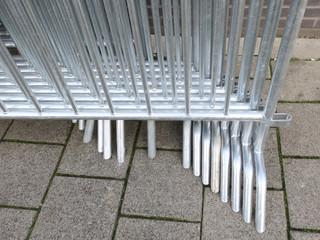 row of metal fences on the sidewalk in Amsterdam