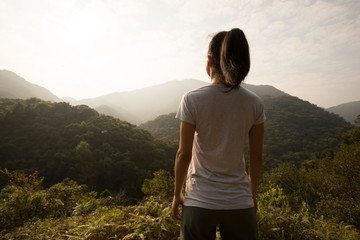 Woman enjoying the view on spring morning mountain valley