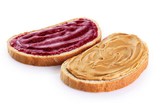 Toasts with peanut butter and  berry jam isolated on white background.