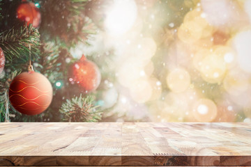 Wooden table with space with Christmas tree and blurred light bokeh for mock up or montage your...