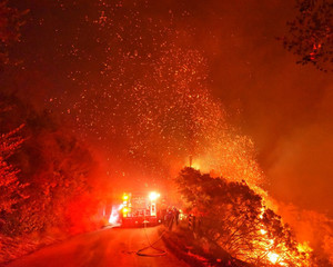 Firefighters battle flames off Highway 154 north of Santa Barbara, California