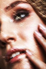 Portrait of beautiful young woman with vogue shining sparkle face makeup