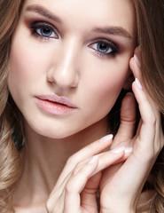 Closeup beauty portrait of young woman
