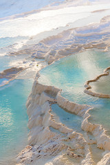 Turkey, Denizli Province, Pamukkale Natural Travertine Thermal Pools at sunset