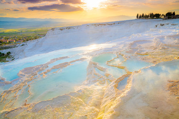 In de dag Oost Europa Turkey, Denizli Province, Pamukkale Natural Travertine Thermal Pools at sunset