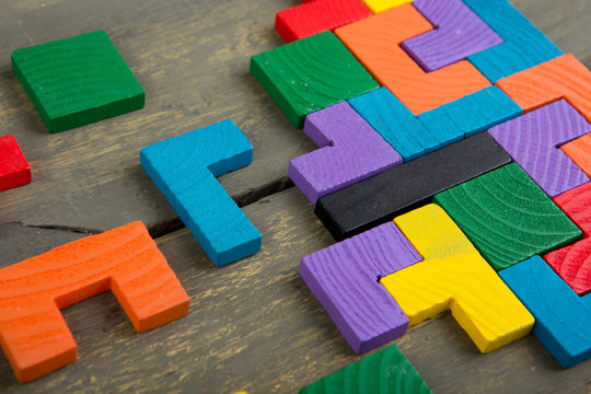 Creative solution for idea - business concept, jigsaw puzzle on the wooden desk