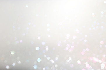 abstract background of glitter vintage lights . silver, gold and white. de-focused