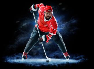 ice hockey player isolated on black background