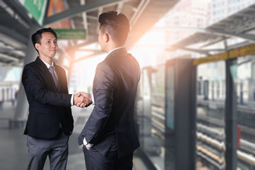 The abstract image of the businessman dealing with another one during sunrise. The concept of agreement, deal, business, cooperation, partnership and successful.