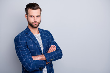 Photo of candid confident man with arms crossed standing near empty space looking at you intently...