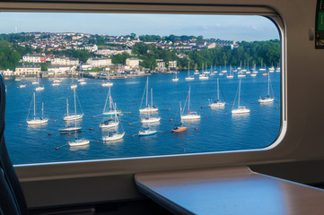 British landscape with yachts from a train window in motion