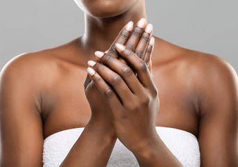 Fototapete - Unrecognizable afro woman applying moisturizing cream to her hands