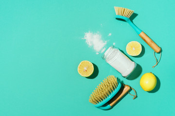 Flat lay composition with eco-friendly natural cleaners. Baking soda, salt, lemon, mustard powder and bamboo brushes on blue background. Top view. Copy space. Flat lay. Homemade green cleaning. Wall mural