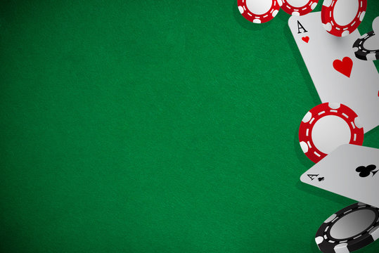 Poker playing cards and chips  green background